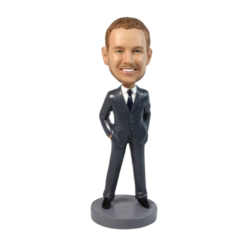 well dressed man bobble head