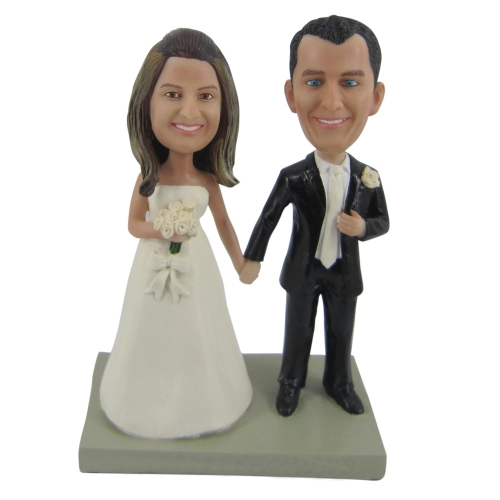 groom and bride hand in hand wedding bobble head