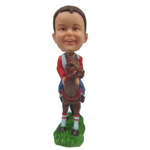 boy riding horse bobblehead