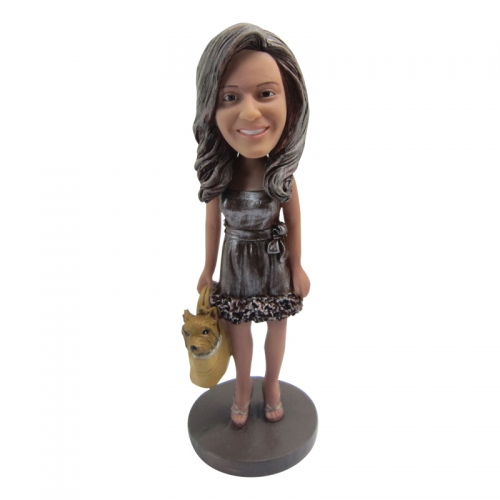 woman with dog bobble head